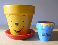 I like how they have a larger flower pot for Pooh and a smaller one for the honey jar. So cute.