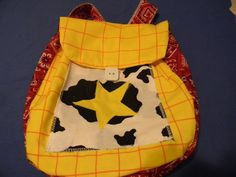 This is a Woody backpack from Toy Story. Has bandanna stripes and a star.