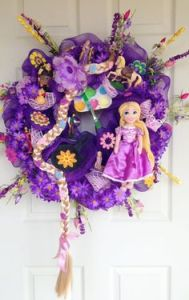 Because this wreath is from Tangled and depicts Rapunzel. Like the blond braid in this which seems fitting.