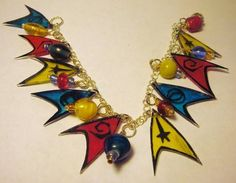 Has Starfleet insignia and beads in 3 different colors. So it will match any Starfleet uniform.