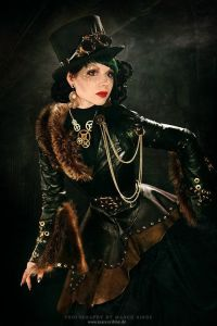 You can bet she's dressed to the nines and her costume isn't cheap. Like how it's black leather trimmed with fur.