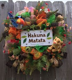 "Don't know why this wreath doesn't include Timon and Pumbaa. Because ""Hakuna Matata"" is their song."