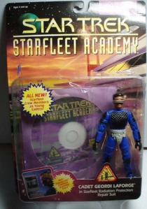 "From The Robot's Voice: ""Packaged with a CD-ROM–which ran on Windows 95 no less!–Playmates' Starfleet Academy line of figures included what was intended to be young versions of Picard, Riker, Geordi and Worf. Each varies in degrees of dreadfulness, but La Forge tops all of them. The sick minds of Playmates' developing staff decided that he would strut around campus in a silver codpiece. It was probably one that he engineered to do all sorts of kinky stuff to that Brahms girl in his Temporal Causality 101 class. Creepy. No wonder dude couldn't ever get laid."""