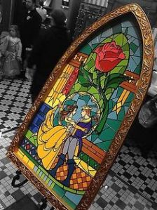 It's the stained glass window of Belle and the Prince at the end of Beauty and the Beast. And yes, the rose is prominently featured.