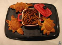 Don't worry, the meal worms are pasta. However, I do like the breaded crabs though. So creative.