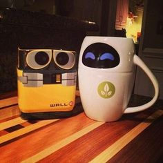 Here we have WALL-E and EVE mugs by the fireplace. So adorable.