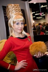 Here she is with a tribble and a basket weave (on her head). And yes, her hair was like that in the original series, too.
