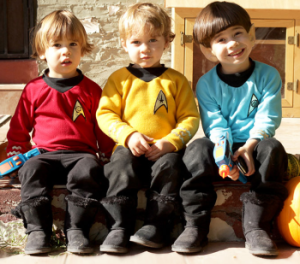 Let's see, there's Kirk, Spock, and I hope the kid in red is Scotty. If not, then I think he's doomed.
