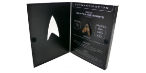 "From What Culture: ""Now why wouldn't you take a 497-year old meteorite and carve it into a Star Trek symbol, and then glue it onto a DVD case for a one-off edition of Star Trek Into Darkness on Blu-Ray? Called the Meteorite edition, with a limited edition of one, this was given away as a prize win for Total Film magazine earlier in the year. It is bonkers. Next we'll have dinosaur bones carved into toothpicks to promote Colgate toothpaste. The meteorite itself fell in 1516 AD in the Guangxi-Zhaung province of China from the Nantan meteorite shower. It has to be the most ridiculous limited edition bonus item I've ever seen with a home media release. At least thankfully they didn't do a run of a thousand of these."""