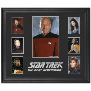 "From The Robot's Pajamas: ""Above is a series of photos of the TNG cast that look like they belong in a high school yearbook. I'm surprised Worf's background isn't a bunch of neon lasers. It's not the most exciting series of images. And they charged $100 for it. That's just adding insult to injury."""