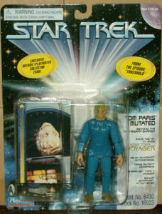 "From The Robot's Voice: ""Remember how Star Trek: Voyager's ""Threshold"" was recently voted by Topless Robot readers to be the stupidest sci-fi TV episode? Well, that televised groin punch also gave us this figure of Tom Paris. It's unlikely that any Voyager fan was clamoring for a figure of a mutated version of the show's most milquetoast character dressed in nursing scrubs, but they got it anyway. Devotees of the episode's bullshit fish creatures will be filled with joy to learn that this toy also came with three of the baffling writer's constructs as accessories."""