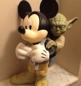 Yes, Mickey has Master Yoda on his back. Yoda is training Mickey to be a jedi. Don't really see him as one to be honest.