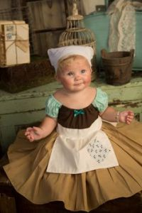 This is a baby Cinderella in rags costume. Wonder if it comes with its own little broom and dust bin.