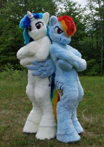 Not sure who the white and blue unicorn is. But the other one is Pinkie Pie. Sorry, but I'm not familiar with My Little Pony.
