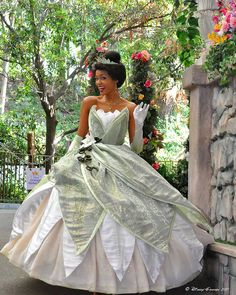 I think she might be a costumed character. But I don't see a lot of Tiana costumes around. So I have to go with what I have.