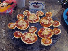 They're made the same way as regular small pizzas. But with Mickey Mouse ears of course.