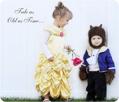 I guess these two are brother and sister. Love the little boy's beast outfit. So cute.