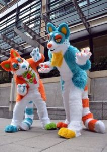 Because these two are in bright colors that you wouldn't see on most mammals in nature. Neon orange and bright blue, come on.