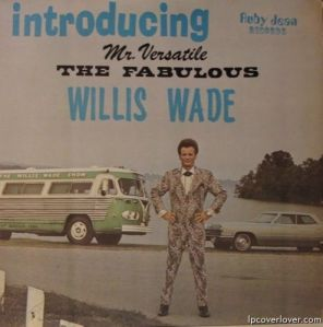 That has to be one of the most hideous suits I have ever seen. Those cars look pretty lame, too.