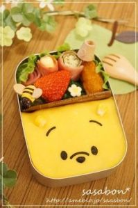 Yes, it's a bento Winnie the Pooh lunch. And it has Pooh made of cheese. But it's adorable to say the least.