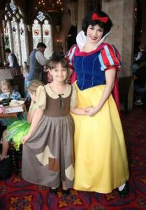This little girl is dressed as Snow White in rags. And here she is with a Snow White at Disney. Seems so proud.