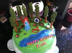 It's of Merida shooting arrows in the forest. Also has trees that are made from icing and pretzel sticks.