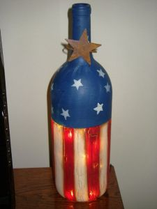 This old wine bottle is painted red, white, and blue. And it has something lighting up inside as well. Yes, it's quite amazing.