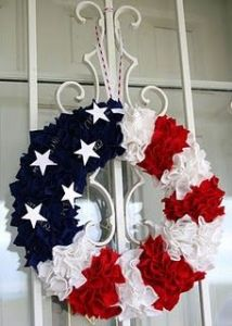 Not sure what it's made from. But it's certainly a 4th of July wreath anyone could hang on their front door. Like the stars, too.