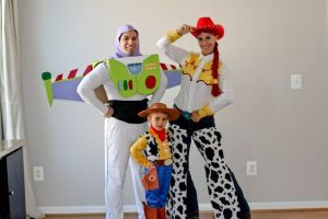 After all, Buzz tends to have a thing with cowgirls. But I like how the dad's Buzz costume is DIY. Guess this is a Toy Story family.
