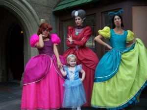 These women are great in their roles. And the little girl in the Cinderella gown is smiling. Love it.