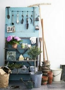 Well, you can hold your garden tools on the hooks and the plants on the shelves. Not sure where you put the rake or pots.