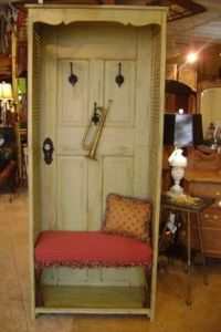 This one uses a door panel and long shutters. It also includes hooks and a cushioned bench.