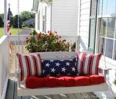 This set has a red seat with 2 striped pillows and 1 long pillow with stars. A great American outdoor arrangement, may I say.