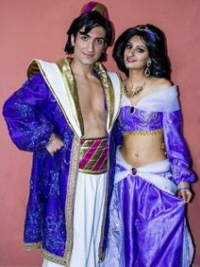 I guess this is what Aladdin and Jasmine wore at the end. And Al always has to have a bare chest. But at least they match.