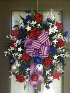 And it helps because it has red, white, and blue jingles that jangle. Love the flowers on this though. Very pretty.