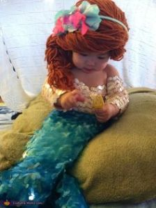 She even has Ariel's red hair in yarn and in a braid. So adorable.