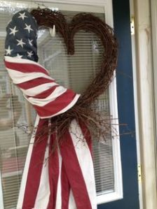 Yes, this is a heart wreath draped with an American flag. And yes, it's a patriotic piece of beauty just the same.