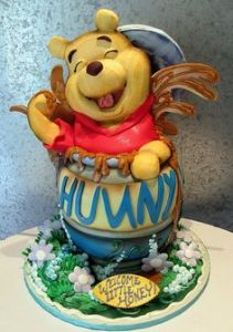 Yes, Pooh is certainly loving this. Cake may be professionally made but it's adorable.