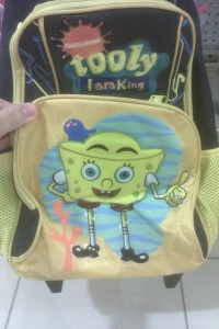"However, this backpack says, ""Tooly, I am your king."" Really disturbing message on a kid's pack."