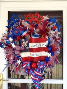 "Yes, it says ""God Bless America"" on it with a heart shaped wreath. But it surely looks patriotic and festive to me. So it goes on this post."