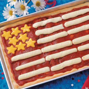 Because it's a flag cheese pizza with mozzarella stick stripes and cheddar stars. And I'm sure it's quite tasty.