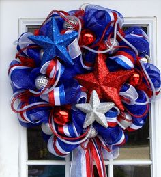 Now that's a great front door patriotic display on a wreath. Love the glittery red, white, and blue stars, too.