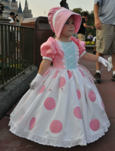 And here she is in a little pink dress and bonnet. So adorable that she'll just melt your heart.