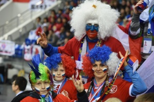 Here's a Russian family in their team spirit. All are donned in their ridiculous clown wigs and flag colors. The father even painted his face.