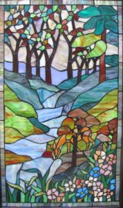 This one depicts a stream with flowers and trees. And in a rather abstract style, too.