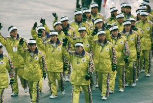 I guess 1980s ski outfits weren't on their way out at this point. And Team South Korea has to parade in PennDOT yellow.