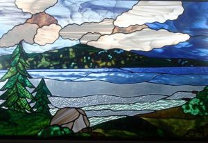Here's another stained glass landscape. This depicts a mountain scene. Love the blue lake and sky.