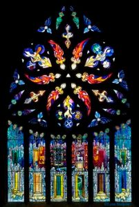 Some church windows might have a lot of abstract imagery like this one. However, the symbols on this one are hard to see from this photo.