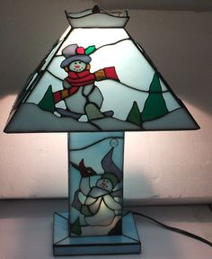 I know it's a Christmas one. But the snowmen on this are so adorable. And most stained glass lamps usually have flowers and shapes on them.