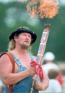 However, he also decided to dress in a way that's mocking his fellow country men earning at a significant lower income level. Also that torch is made from Bud Light beer cans.